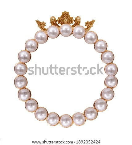 Golden frame with pearls and crown for paintings, mirrors or photo isolated on white background. Design element with clipping path
