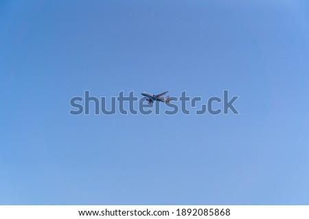 A low angle shot of a plane in blue sky in Split, Croatia #1892085868