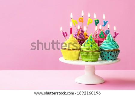 Happy birthday cupcakes on a cakestand Royalty-Free Stock Photo #1892160196