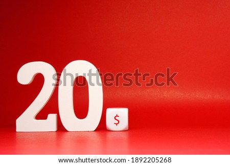 Twenty dollar ( 20$ )  Isolated on Red Background with Copy Space , White object word - Sale , Discount 20$ off Safe Price shopping advertise promotion Concept - Creative mockup Royalty-Free Stock Photo #1892205268