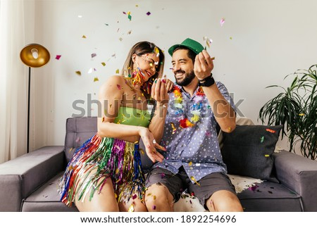 Brazilian Carnival. Couple celebrating carnival at home Royalty-Free Stock Photo #1892254696