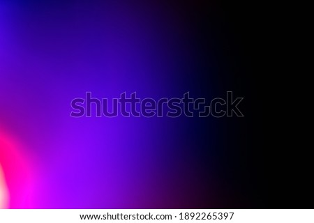 Neon light background. Blur fluorescent glow. Defocused blue purple magenta pink color gradient radiance on dark black abstract wallpaper with empty space. Royalty-Free Stock Photo #1892265397