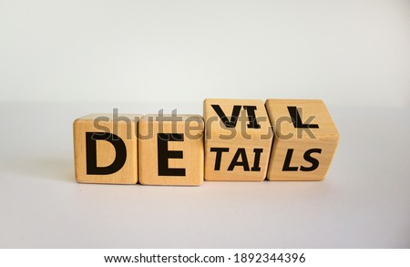 Devil in the details symbol. Turned cubes and changed the word 'details' to 'devil'. Beautiful white background. Business and devil in the details concept. Copy space. Royalty-Free Stock Photo #1892344396