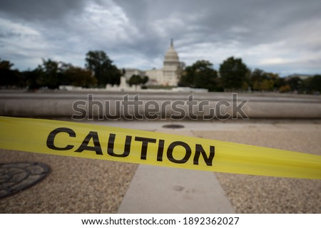 A caution sign at the US Capitol building in Washington, D.C. Royalty-Free Stock Photo #1892362027