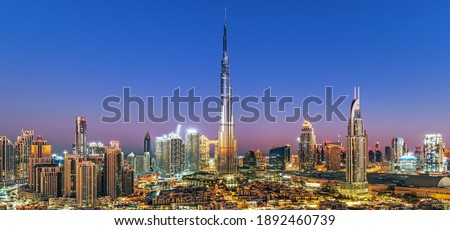 Dubai - city center skyline and bussy evening after sunset with colorful sky, United Arab Emirates Royalty-Free Stock Photo #1892460739