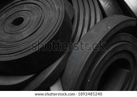 Close-up rubber sealing strips for waterproof doors. A pile of rubber twisted into rolls. Royalty-Free Stock Photo #1892485240