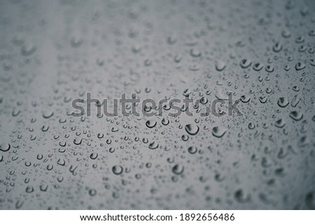Waterdrop on glass. Water droplets on glass background. Royalty high-quality stock photo image of water drops texture abstract. Wet water on glass background. Close up of bubble pattern rain concept