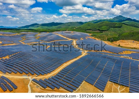 Aerial view of Solar panel, photovoltaic, alternative electricity source - concept of sustainable resources on a sunny day, Xuan Tho, Song Cau, Phu Yen, Vietnam Royalty-Free Stock Photo #1892666566
