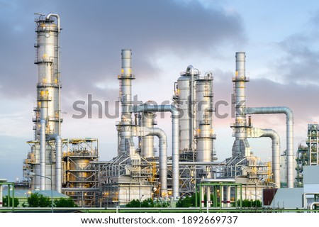 Gas fired power plant and factory building at night. Also called gas fired power station or natural gas power plant. That technology to burn natural gas and generate electricity or electrical energy. Royalty-Free Stock Photo #1892669737