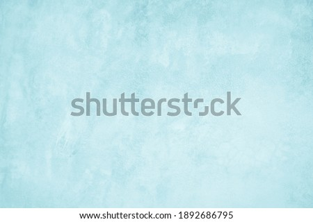 Pastel Blue and White concrete stone texture for background in summer wallpaper. Cement and sand wall of tone vintage. Concrete abstract wall of light cyan color, cement texture mint green for design. Royalty-Free Stock Photo #1892686795