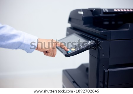 Bussiness man Hand press button on panel of printer, printer scanner laser in office copy machine supplies start concept. Royalty-Free Stock Photo #1892702845
