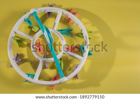 Baby clothes hangers isolated on yellow background, JPEG large file