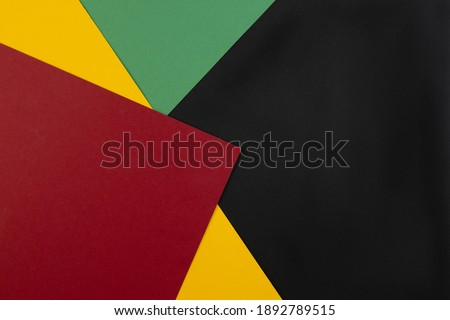 February Black History Month. Abstract Paper geometric black, red, yellow, green background. Copy space, place for your text. Top view. Royalty-Free Stock Photo #1892789515