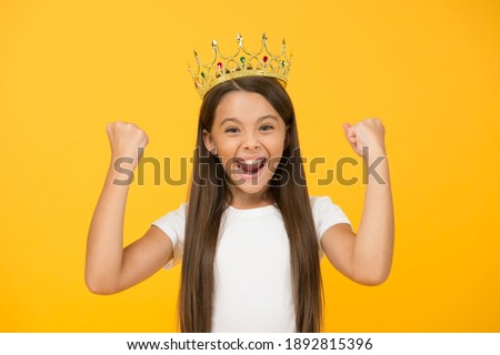 Just look at me. Princess concept. Girl princess. Lady little princess. Compelling baby. Kid wear golden crown symbol of princess. Girl cute baby wear crown yellow background. Success and happiness. Royalty-Free Stock Photo #1892815396