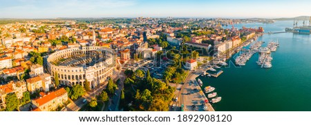 Aerial drone photo of famous european city of Pula and arena of roman time. Location Istria county, Croatia, Europe. Popular touristic place. UNESCO world heritage site. Discover the beauty of earth. Royalty-Free Stock Photo #1892908120