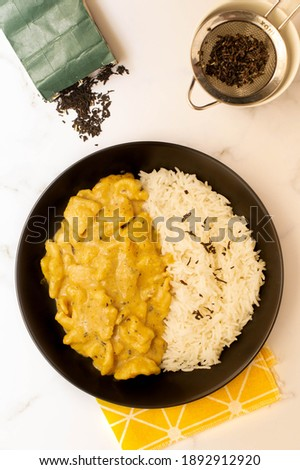 Coconut black tea with curry chicken and white rice.