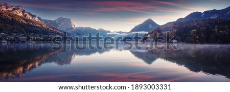 Impressively beautiful Fairy-tale mountain lake in Austrian Alps. colorful  Scenery. Panoramic view of beautiful mountain landscape in Alps with Grundlsee lake, concept of an ideal resting place.   Royalty-Free Stock Photo #1893003331