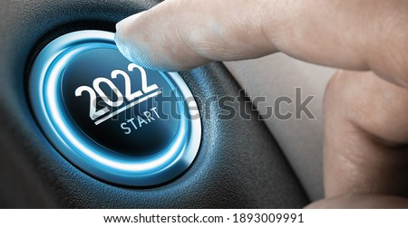 Finger about to press a car ignition button with the text 2022 start. Year two thousand and twenty two concept. Composite image between a hand photography and a 3D background. Royalty-Free Stock Photo #1893009991