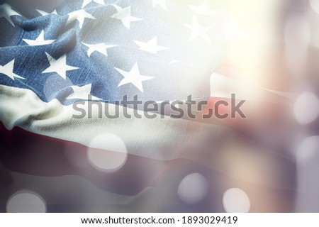 American flag for Memorial Day, 4th of July or Labour Day, blue bokeh background