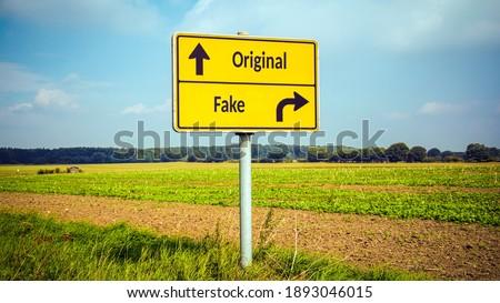 Street Sign the Direction Way to Original versus Fake Royalty-Free Stock Photo #1893046015