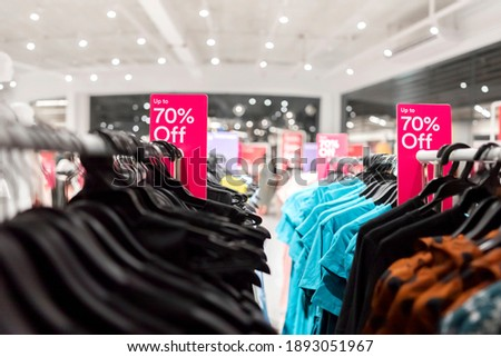 Big sale tag announcement at clothes shop, Black friday and shopping concept, Red tag 70 percent discount price in shop