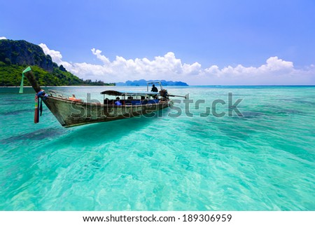 Wooden boat and blue water ocean, Krabi Thailand #189306959