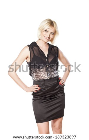 short haired blonde in a black dress posing on white #189323897