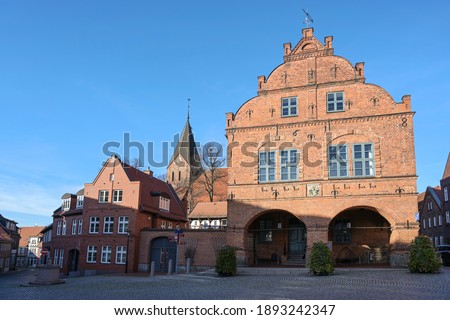 Market place in the city of Gadebusch with the medieval town hall and church in red brick architecture against a clear blue sky with copy space, Mecklenburg-Western Pomerania, Germany Royalty-Free Stock Photo #1893242347