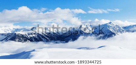 Panoramic view of mountains near Brianson, Serre Chevalier resort, France. Ski resort landscape on clear sunny day. Mountain ski resort. Snow slope. Snowy mountains. Winter vacation. Panorama, banner. Royalty-Free Stock Photo #1893344725