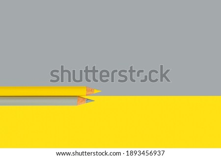 Pencils in trendy Ultimate Gray and Illuminating colors of the year 2021, isolated on ultimate gray and illuminating background with copy space. Royalty-Free Stock Photo #1893456937