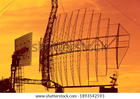 Large radar installation against a bright sky Royalty-Free Stock Photo #1893542593