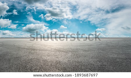 Asphalt race track road and sky clouds.Road ground background. Royalty-Free Stock Photo #1893687697