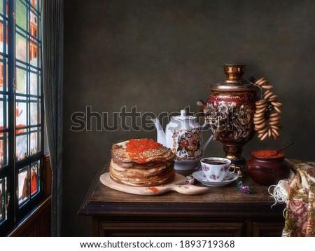 Still life with tea from a samovar and pancakes