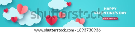 Horizontal banner with blue sky and paper cut clouds. Place for text. Happy Valentine's day sale header or voucher template with hearts. Royalty-Free Stock Photo #1893730936