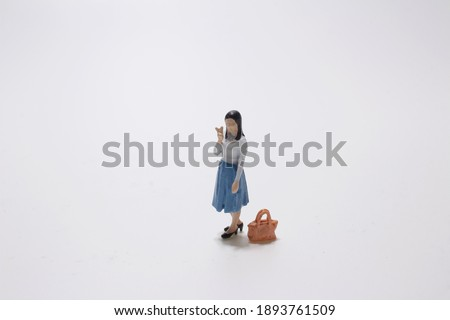 miniature figures of human with Different occupation Royalty-Free Stock Photo #1893761509