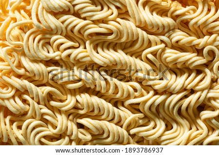 Macro instant raw noodle. Close-up uncooked ramen texture. Food background, top view