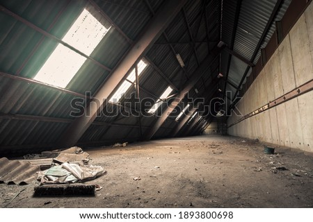 Creepy abandoned industry area with natural decay so-called lost place a decayed factory hall Royalty-Free Stock Photo #1893800698