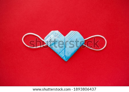 valentine's day during the coronavirus covid pandemic, 14 February 2021. medical mask valentine Royalty-Free Stock Photo #1893806437