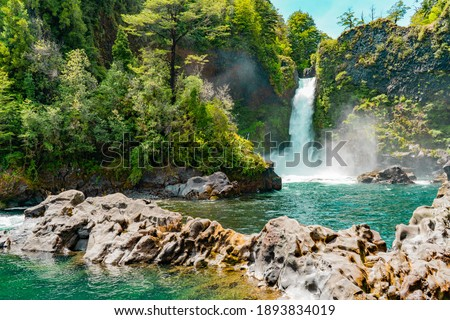 Waterfalls cascading in the beautiful south of Chile.  Royalty-Free Stock Photo #1893834019