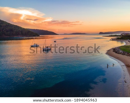 After the storm seascape, sunset flight over the channel at Ettalong Beach on the Central Coast, NSW, Australia. Royalty-Free Stock Photo #1894045963