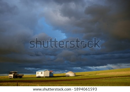 After thunderstorm, a picture of clouds, sunshine, grassland and the nomadism. Shot in Hulunbuir, Inner Mongolia. June 2015