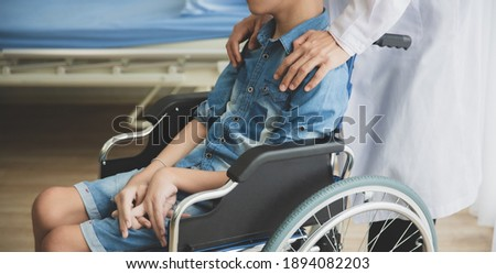 Doctor motivate disabled person patient leg at hospital, Muscle weakness Royalty-Free Stock Photo #1894082203