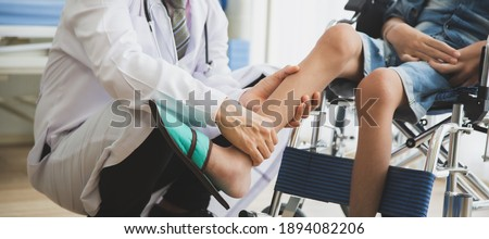 Doctor checking disabled person pateint leg at hospital, Muscle weakness Royalty-Free Stock Photo #1894082206
