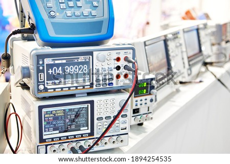 Power supplies and electronic measuring devices in the laboratory Royalty-Free Stock Photo #1894254535
