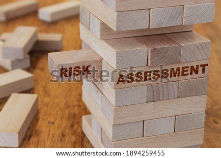 Risk assessment concept using wooden blocks Royalty-Free Stock Photo #1894259455