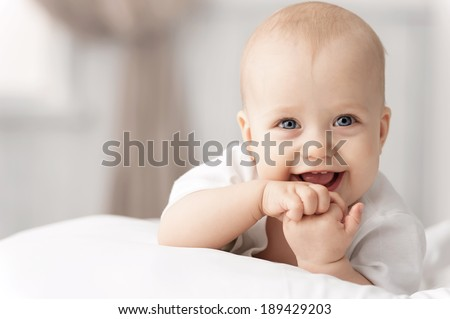 Portrait of a crawling baby on the bed in her room Royalty-Free Stock Photo #189429203