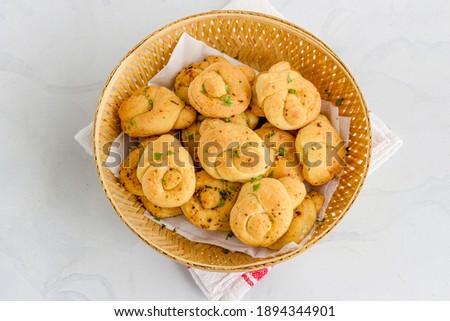 Fresh Garlic Knots in a Basket Top Down Photo Royalty-Free Stock Photo #1894344901