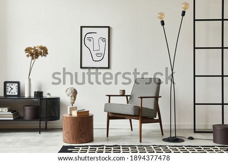 Stylish scandinavian composition of living room with design armchair, black mock up poster frame, commode, wooden stool, book, decoration, loft wall and personal accessories in modern home decor. Royalty-Free Stock Photo #1894377478