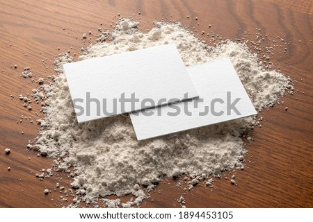 Blank business cards on the flour, and wooden table branding mockup, empty space to display your logo or design.