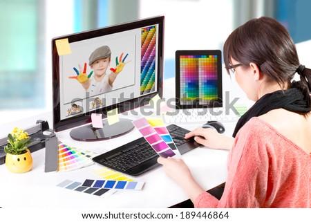 Graphic designer at work. Color swatch samples. #189446864